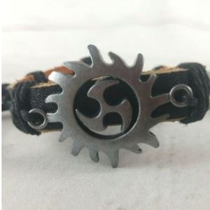 Jewelry - Leather Cuff W/ Tribal Sun/Triskelion Charm